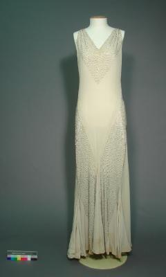 Dress; Cream evening dress with silver beading