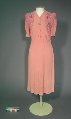 Day dress; Pink fabric with floral details and braiding/cording